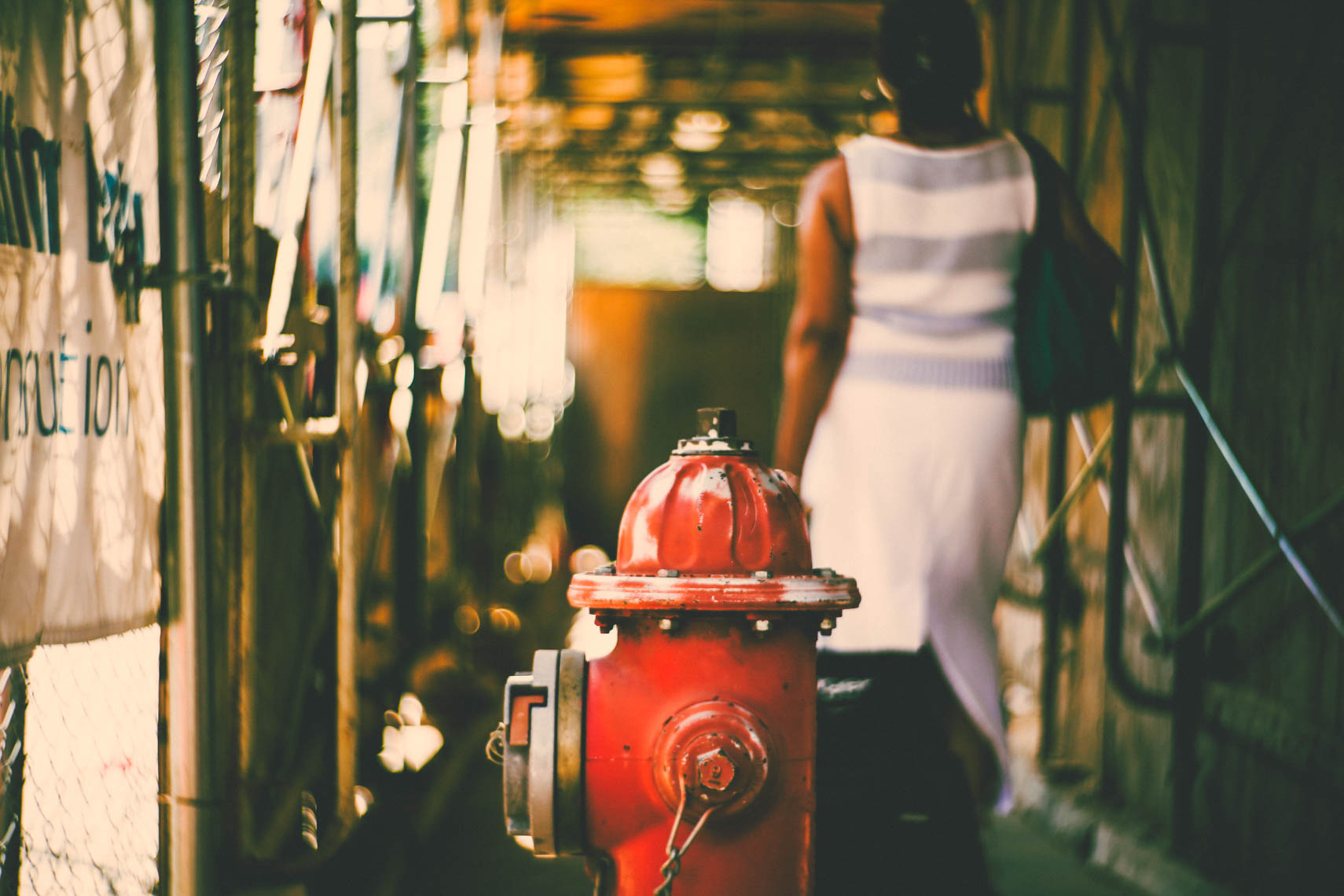 Hydrant and a woman.