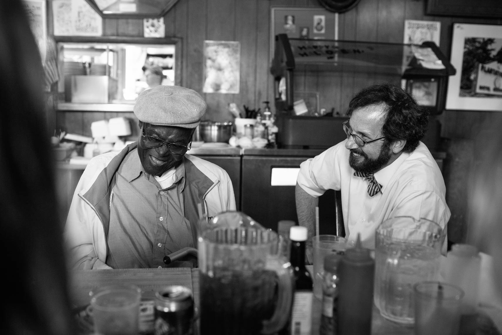 George & Charles at lunch, laughing.